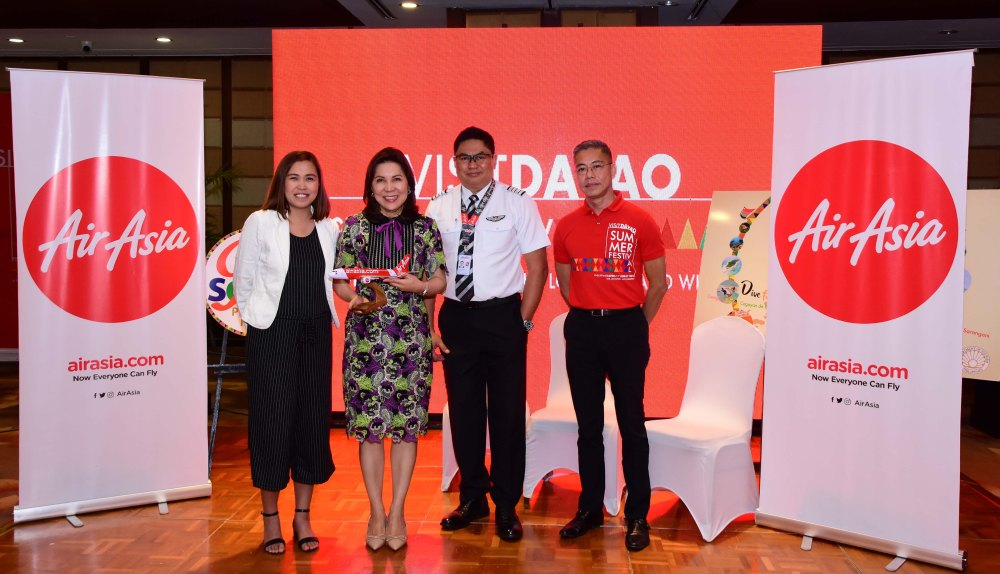 Air Asia with Department of Tourism head Wanda Teo and Visit Davao Summer Festival head Benjie Lisada in Davao